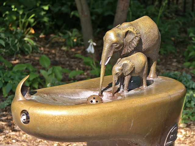 Drinking fountain in the form of a watering-hole with elephant and calf at north end of the Lincoln Park Zoo in Chicago, Illinois.