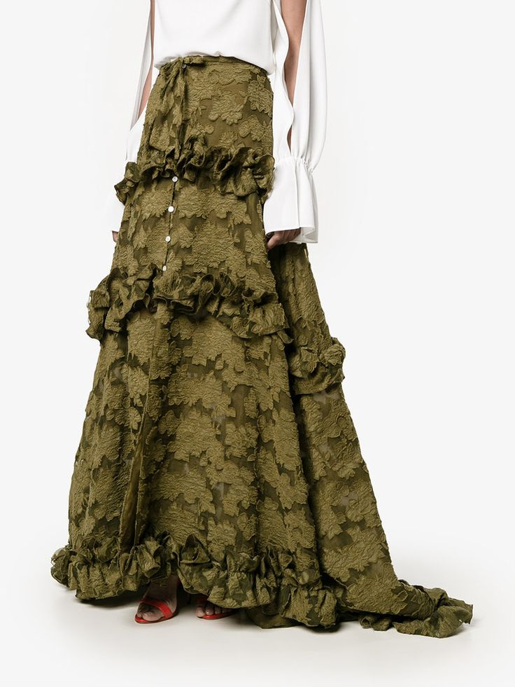 Rosie Assoulin's Olive Silk Embroidered, Appliquéd Formal Skirt. This is Amazing. It has an Extravagant A-Line Silhouette with Tiers of Ruffles to the Floor and a Sweep Train. I'm showing it with a Palest Yellow Pussy Willow Off-The-Shoulder Silk Blouse. Cinch them together with a Wide Gold Belt and add a Multi-Color Shawl. You'll get sparkle from Peridot Jewelry. Finish with Gold Sandals and a Crystal Clutch (It's all on this board). It's Pretty and Totally On-Trend. Good, Huh? - Gabrielle