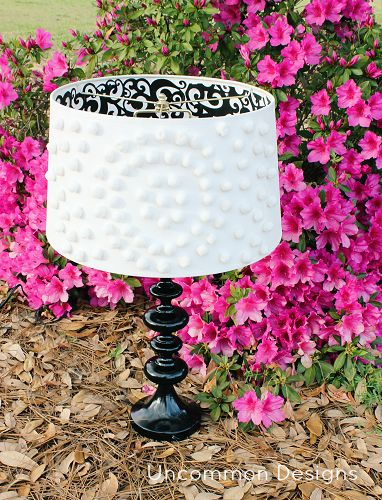 A wayfair lampshade modified with black and white scrapbook paper and pom poms! So cute! via @Bonnie &  Trish { Uncommon Designs }