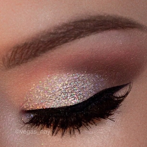 Nude and sparkly eye shadow.