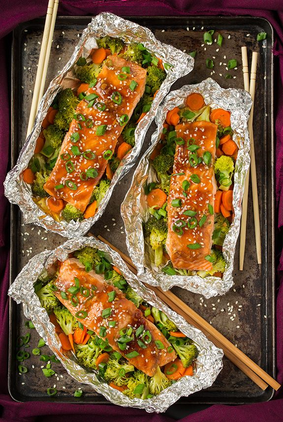 Honey Teriyaki Salmon and Veggies in Foil  I'd probably try with different veggies as carrots and broccoli aren't my favorite!