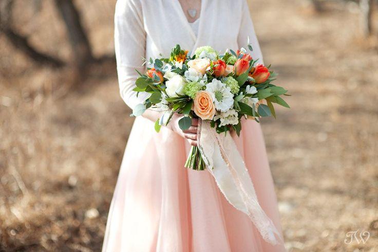Peach, white and orange spring bridal bouquet with tulips, viburnum and scabiosa flowers.  Calgary Wedding Flowers www.flowersbyjanie.com  Photo: @tarawhitphoto