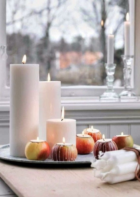 Scandinavian Fall Décor Ideas | DigsDigs  ~  Love the idea of the fruit for the tea lights.  Oranges, maybe??