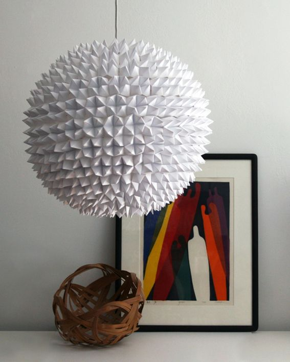 "Made from ""folded up fortune-tellers from your elementary school days""  ~ http://www.curbly.com/users/kellyb/posts/11292-make-this-a-luminous-faceted-pendant-light"