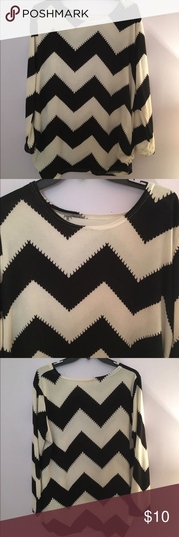 Chevron tunic Fits a variety of sizes but it's juniors large. It's an oversized tunic and it's kind of a sweater material. Tops Tunics