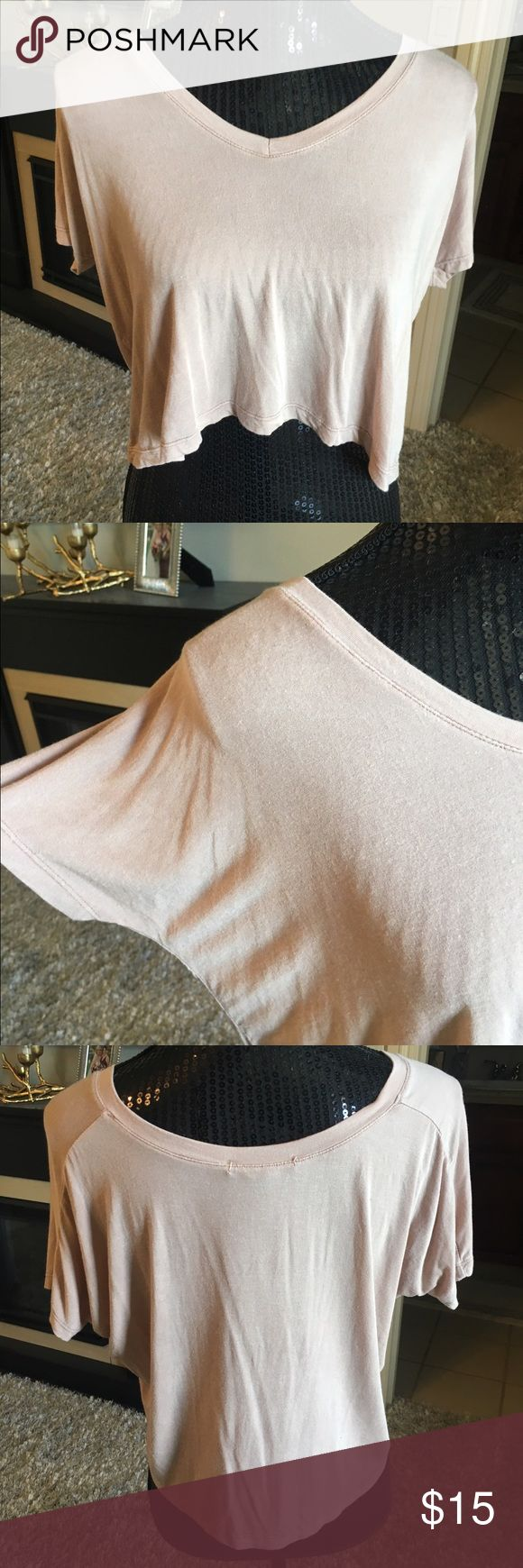 Brandy Melville cream crop top NWOT Brandy Melville cream crop top NWOT I never wore this! It's super cute and loose and fun! ONE size Brandy Melville Tops Crop Tops