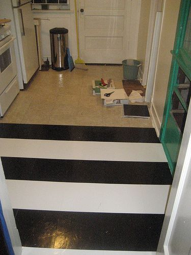 cheap, cute, temporary way to fix my ugly kitchen floor. I think the stripes might make it look bigger in there too