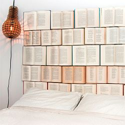 An easy DIY headboard made of thrifted vintage books. Would be better with vinyl overlay or shadowboxed- otherwise you couldn't prop up against your headboard.