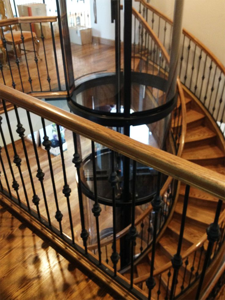 This Rustic Staircase Looks Beautiful With A Visilift™ Round Elevator  Tucked Inside.