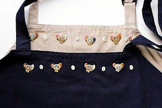 aprons embellished with tiny Incomparable chicken and egg buttonsTiny Incompar, Incompar Chicken