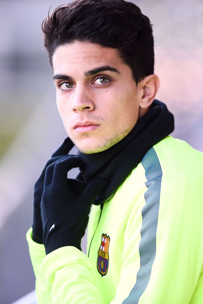 Marc Bartra of FC Barcelona looks on during a training session ahead of their UEFA Champions League Group F match against Paris Saint-Germain FC at Ciutat Esportiva on December 9, 2014 in Barcelona, Catalonia.