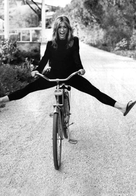 jen aniston on a cute vintage bike