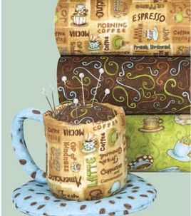 I just want the fabric!!!  Cup and saucer pin cushion
