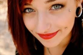 cheek piercings :) mayyybee... They're soooo cute to me! <3333