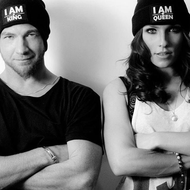 """The beautiful and talented Dancing With The Stars (DWTS) pro Sharna Burgess and her man Paul Kirkland rocking Gratitude Couture's anti-bullying """"I AM Queen"""" and """"I AM King"""" beanies in support of our brand and message."""