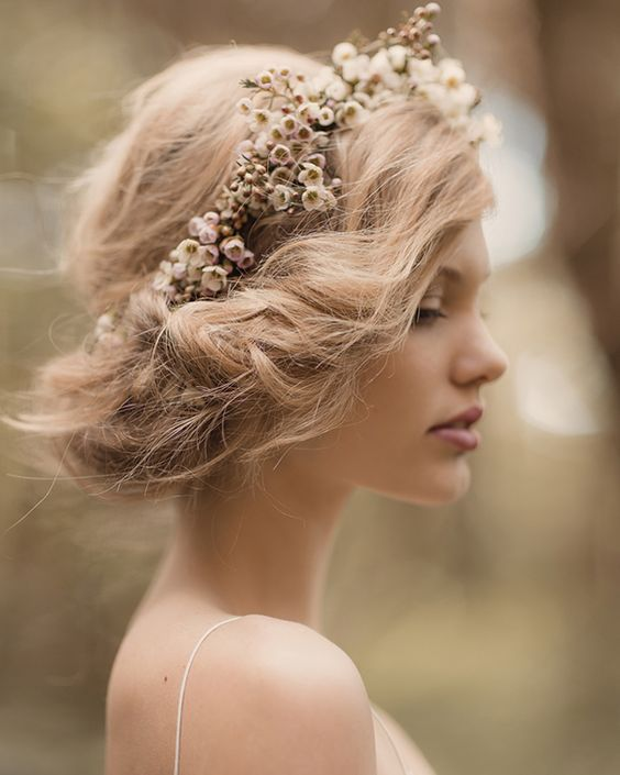 Add a boho flower crown in muted colors to a short wedding hairstyle
