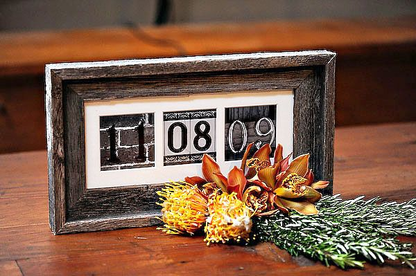 Wedding gift. wedding date framed with house number plates.