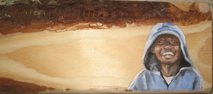 Kura Samouilhan 2013 - boy on an old piece of wood, saved from the fire. (Xmas Present)