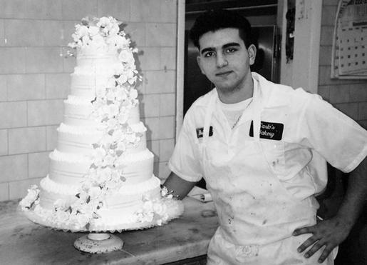 Cake Boss, Buddy, when he was a bussing master baker with one of his first wedding cakes. (TLC image gallery Valastro family photo album)