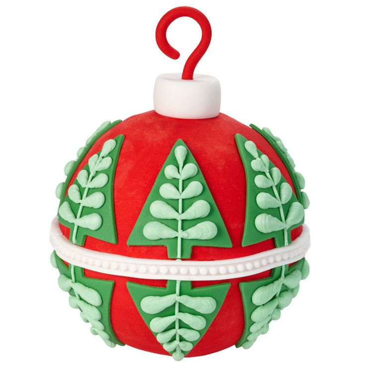 Bring the cheerful style of a traditional Christmas tree ornaments to your holiday table as well as on your tree! This giant ornament cake is iced in buttercream and decked with fondant cut-out trees and trim.