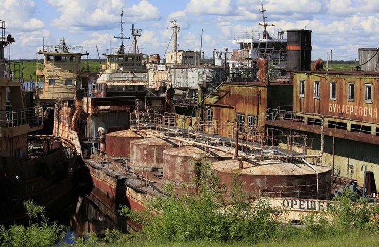 Abandoned ships of the Russian federal fleet, at the shipyard of the river fleet of the Yenisei river shipping company in Podtyosovo village, Russia on June 15, 2013. (Ilya Naymushin)