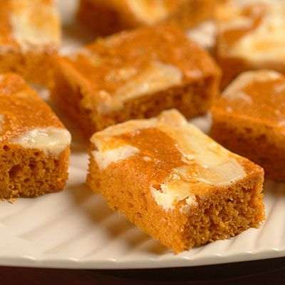 PUMPKIN CARROT SWIRL BARS~ Pumpkin, shreds of carrot and brown sugar make a moist, chewy bar just right for the holiday table. Finished with a cream cheese topping they make a pretty sight for any occasion.