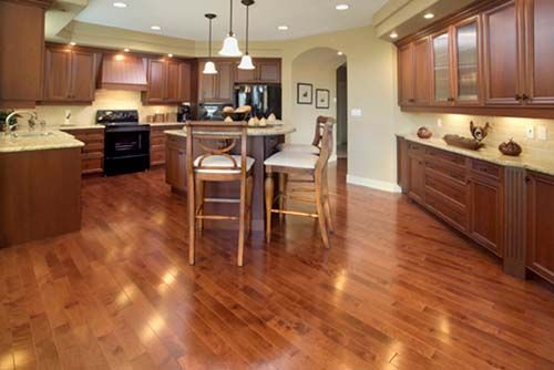 Dark cabinets lighter wood floors light countertops for Cheap kitchen flooring ideas