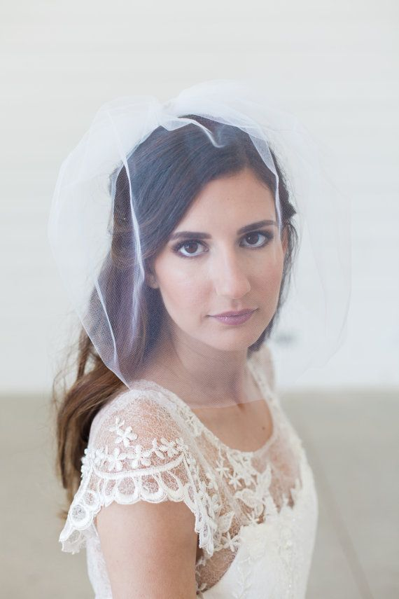 Tulle birdcage veil, Long blusher veil, bird cage veil This classic, retro style birdcage veil is made with tulle netting (shown in champagne in the cover image) and attaches with a small silver wire comb. It is designed to drop below the face and can be adjusted to wear tiled (wedge style) or straight and can be pinned to create more or less fullness for your bridal look. Also, it can be turned around for a cute pouf <<<<<<< DETAILS >>>>>>>>> ~ ❤ Veil in the first two photos measures…