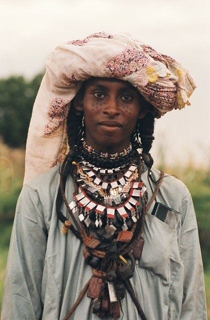Africa | Portrait of a Wodaabe with traditional facial tattoos, braided hair and turban, Chad | © Marie Laure Dedecker #braids #turban #tattoo