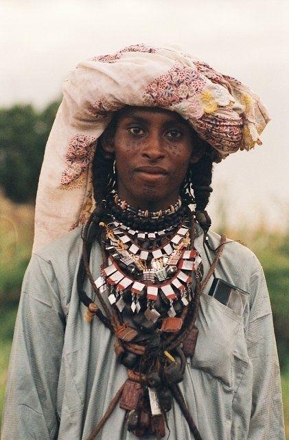 Africa | Portrait of a Wodaabe with traditional facial tattoos, braided hair and turban, Chad | © Marie Laure Dedecker #braids #turban #tattoo
