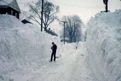 Blizzard of '66. Syracuse, New York - Dad stuck at the firehouse and Mom loading everyone up on the sled to get milk, including Michael who was just a few months old.