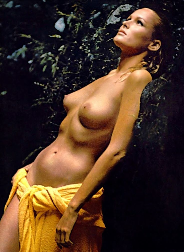 Ursula andress nude leaning on the rock with yellow towel around her waist