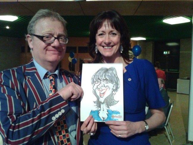 CARICATURIST PAUL BAKER and myself were booked nearly two years ago to entertain the massed ranks of Rotarians at their annual conference in Torquay this year.  We shared the driving of a hired car – a very comfortable Toyota Prius and took full advantage of its bluetooth music capabilities with a discerning selection of tracks on my Samsung mobile phone.