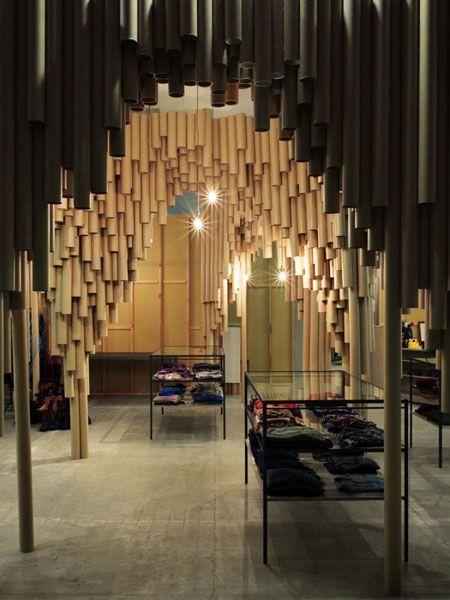 Картонные трубы в интерьере торгового зала Kazuin Ltd от Suppose design