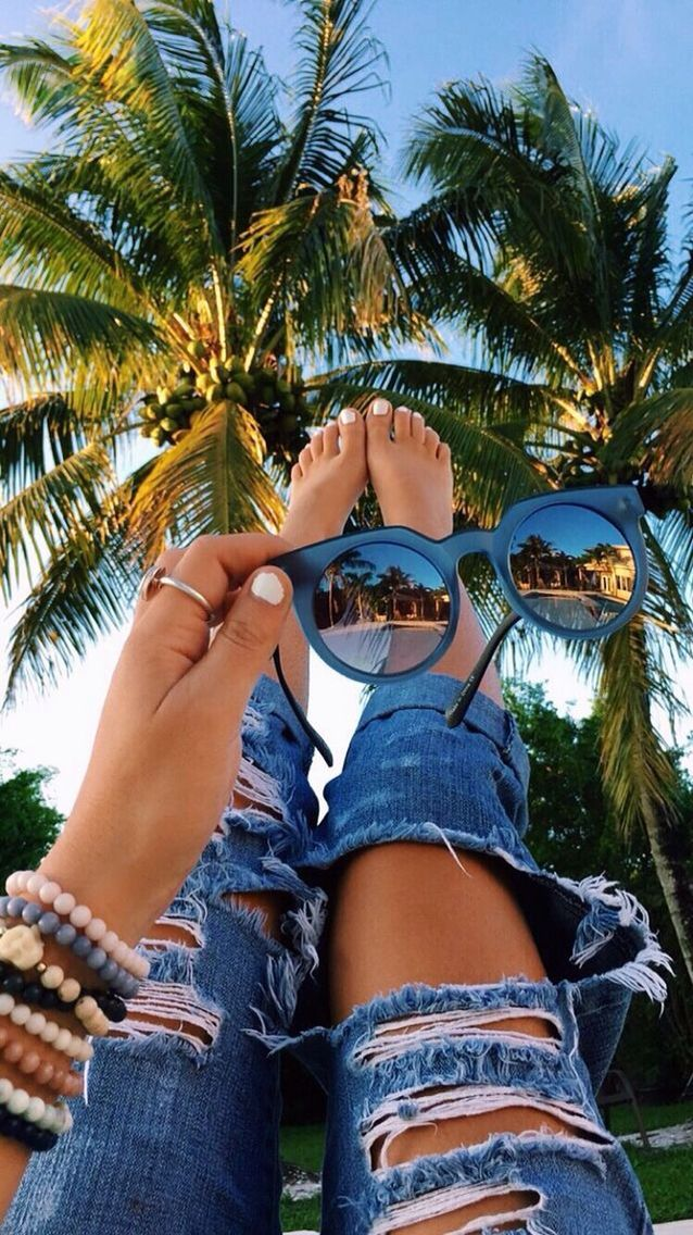 Shades at the ready to chill by the palm trees. xx