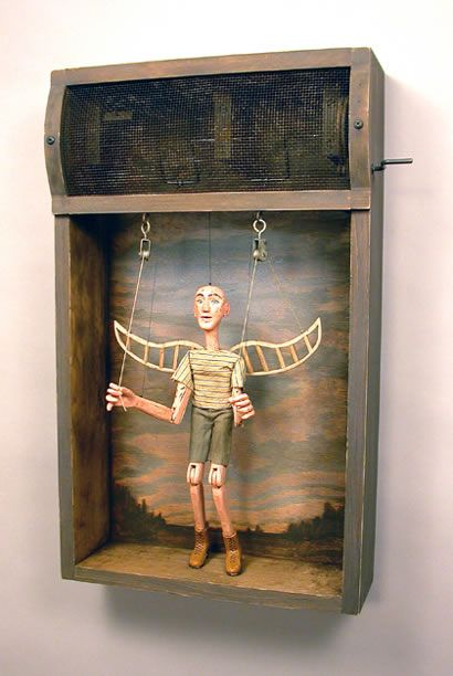 """'The Visionary' ~ Tom Haney When the crank is turned, he yanks down on the strings that raise the """"wings."""" Weights placed in his forearms enable him to actually """"pull"""" down on the strings."""