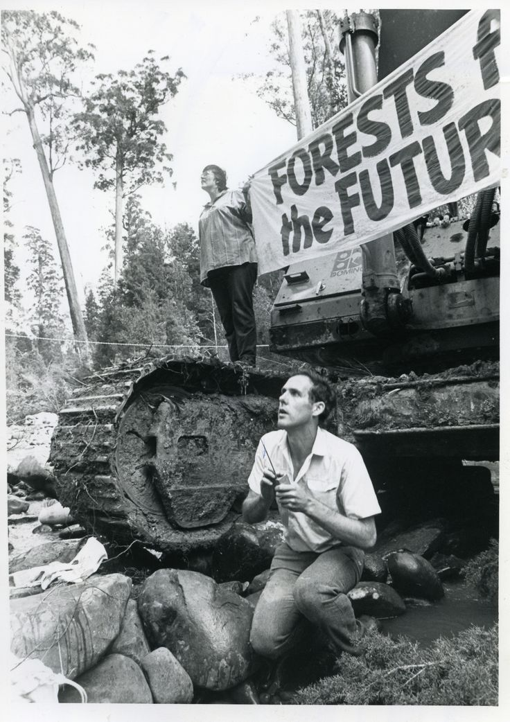 Bob Brown and other protestors stopping the bulldozers, just before arrival of logging vigilantes, Franklin River - 1987