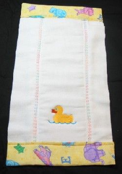 Burp cloth from a folded cloth diaper