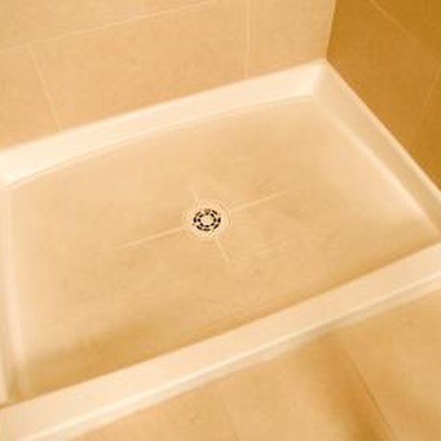 Scrubbing with abrasives actually makes the staining worse on the shower basin.