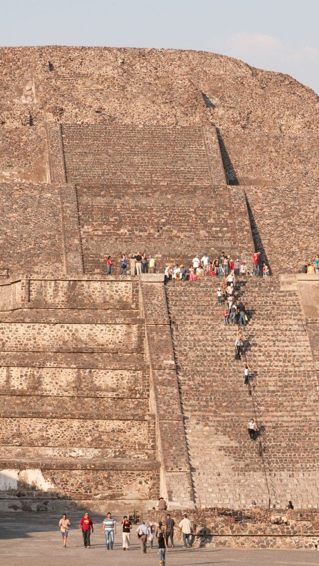 """Teotihuacan, Mexico - Pyramid of the Moon. My husband and I climbed this in 2012. The 'stairs' are very, very steep and made of blocks approximately 18"""" in height. The rope in the center is for hanging on and pulling yourself up!"""