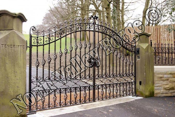 A beautiful hand crafted pair of  wrought iron estate gates