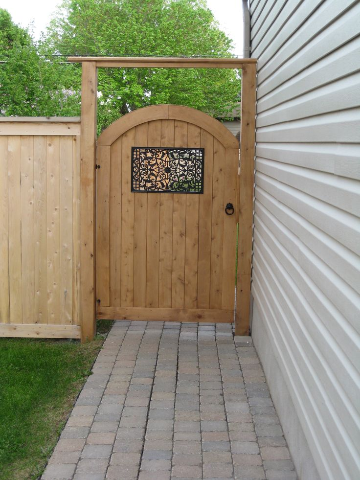 Arched Otty style pre made gate with Nuvo Iron gate insert, Snug Cottage hardware and gate brace.  Supplied by Lanark Cedar