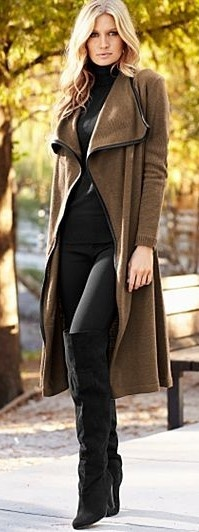 Brown coat....black pants.....black top.....black boots