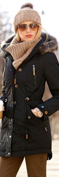 long black winter coat with faux fur at hood + turtleneck knit swetaer + skinny jeans + beanie