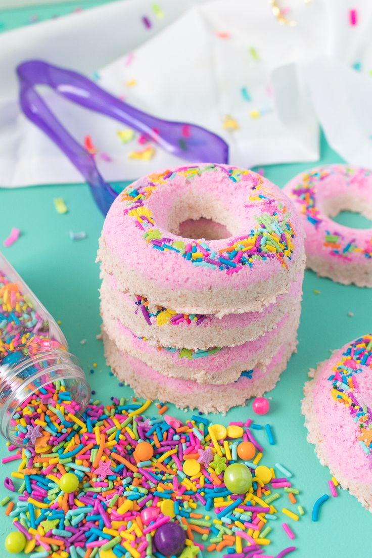 Make a colorful set of DIY donut bath bombs with two layers of homemade bath fizz and topped with colorful sprinkles just like a donut!
