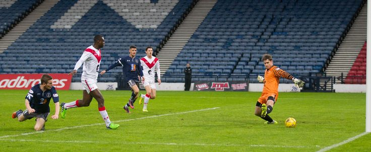 Queen's Park's Gregor Fotheringham scores during the Ladbrokes League One game between Queen's Park and Airdrieonians.