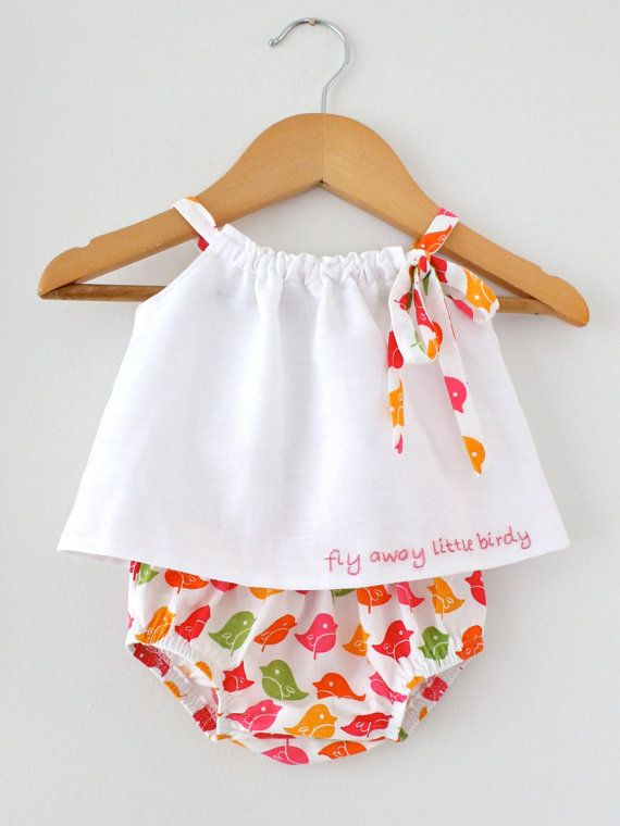 This is a sweet little 2 piece baby outfit made from crisp white pure linen top and designer cotton bloomers. The top is hand embroidered with FLY AWAY LITTLE BIRDY and fully lined in cotton voile.    This is an original and exclusive Chasing Mini outfit in size 0-3mths and Ready to Ship. It is the only one I have and I am not taking orders on this outfit at the moment.    The gorgeous bloomer fabric is in vibrant colours of pinks, orange and green and is so lovely and fresh.    It is such a…