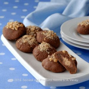 Recipe - Hazelnut Caramel Cookies - Combine chocolate, butter and NESTLÉ Sweetened Condensed Milk in a medium saucepan, stir over low heat until the mixture is smooth.  Stir in the vanilla essence and flour and mix to combine.