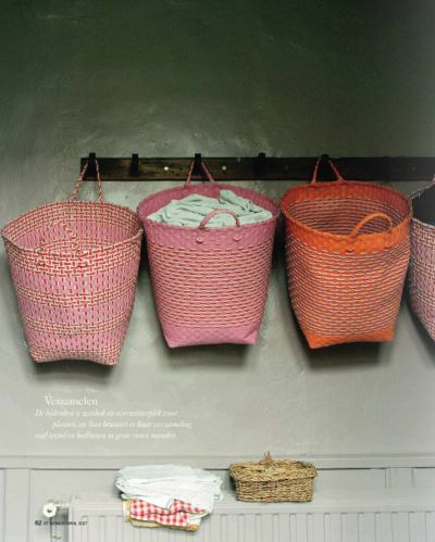 woven baskets on wood pegs