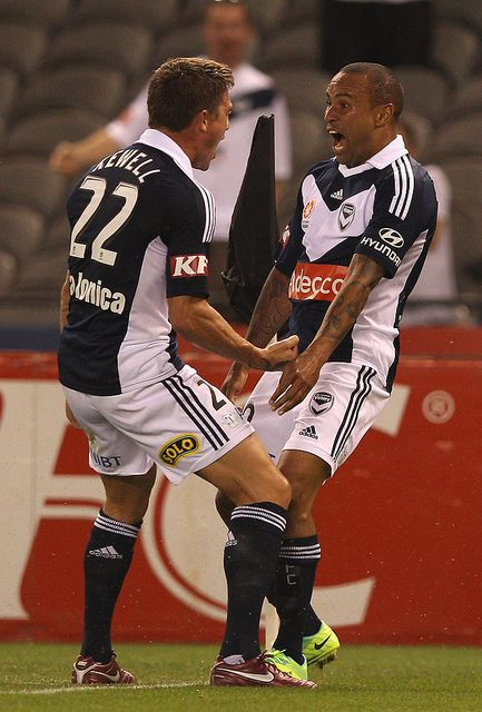 Archie Thompson of the Victory is congratulated by Harry Kewell after scoring a goal during the round five A-League match between the Melbourne Victory and the Brisbane Roar at Etihad Stadium on November 5, 2011 in Melbourne, Australia.